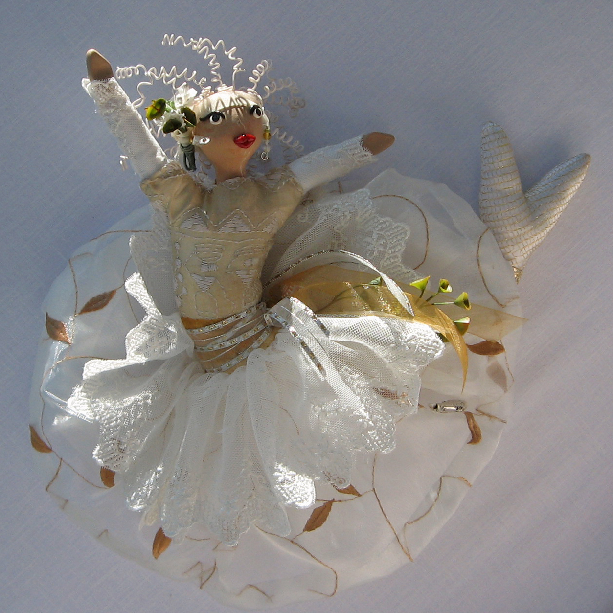 """""""Leukothea, Greek Goddess of the Sea."""" Soft-sculpture CallyWally made of fabric, faux foliage and Sculpey oven-baked clays. Approx. 12"""" tall."""